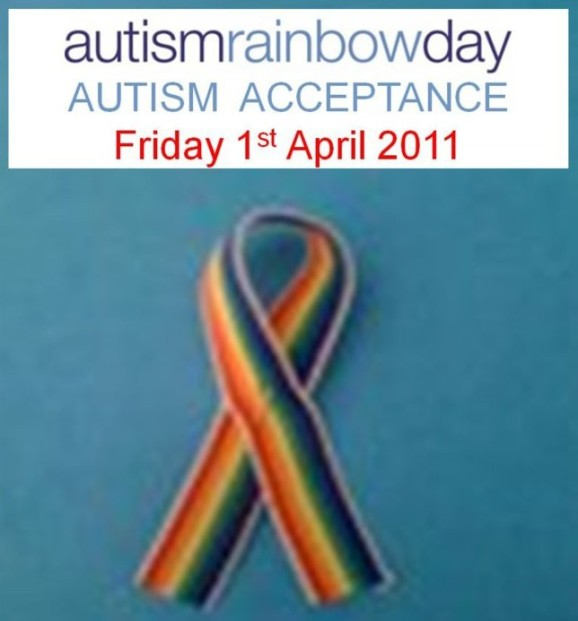 """Pic ID: a rainbow colored ribbon with the words above """"autism rainbow day, autism acceptance, Friday 1st April 2011"""""""