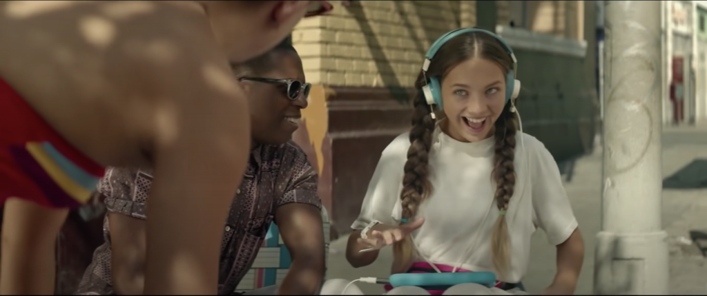Screenshot of Maddie Ziegler playing the role of an autistic young woman named Music